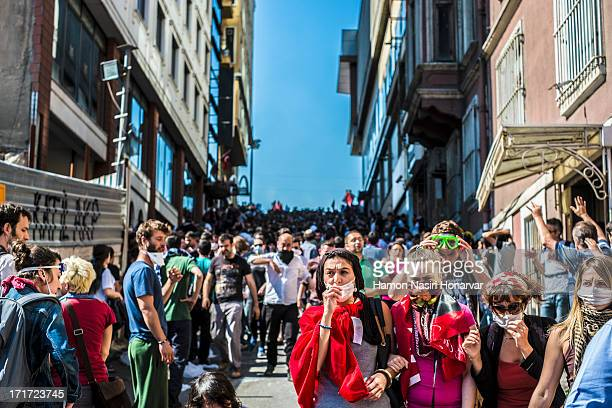 CONTENT] Turkey Istanbul Occupy Gezi 2013 Teargas attack on crowded area in front and and on the Taksim Square Occupied by people and flags...