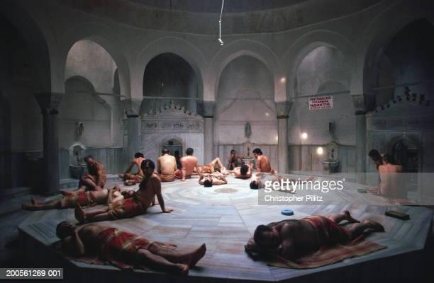 Turkey, Istanbul, people relaxing at Chemberlitas baths