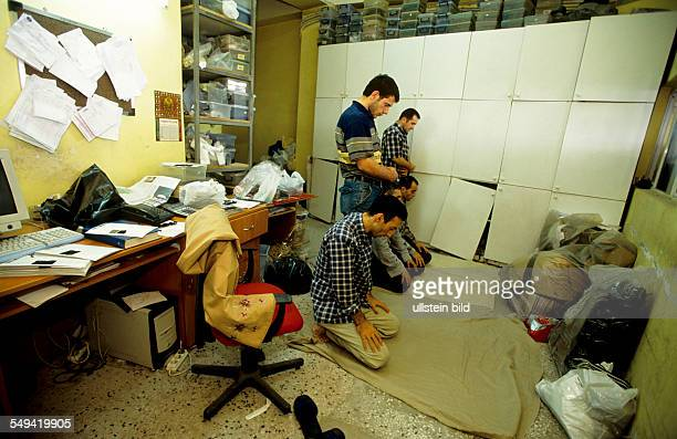 Turkey, Istanbul: TEKBIR is specialized in fashion for muslims, workers are praying near her workplace.
