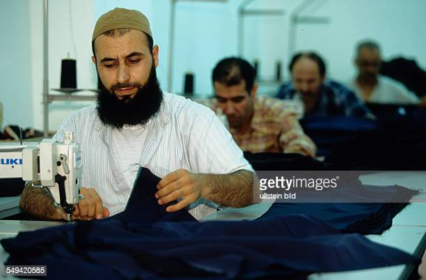 Turkey, Istanbul: TEKBIR, specialized in fashion for muslims. The men are working in the production
