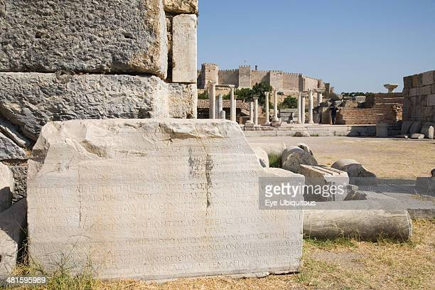Turkey Izmir Province Selcuk Ruins of the 6th century Basilica of St John the Apostle with piece of inscribed stone and fallen masonry in foreground