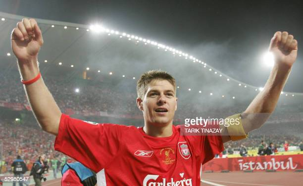 Liverpool's England's captain and midfielder Steven Gerrard greets supporters during the honour lap at the end of the UEFA Champions league football...