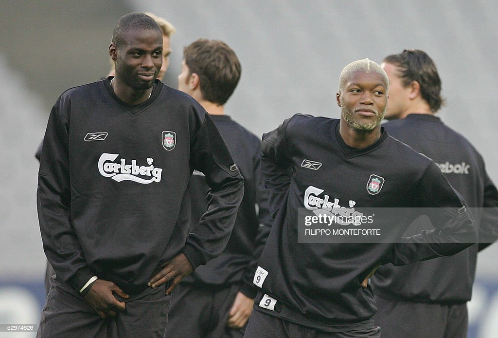 Liverpool?s French players Djibril Cisse and Djimi Traore (R) stretch during a training session at Ataturk Olympic Stadium in Istanbul 24 May 2005 on the eve of the UEFA Champions League final football match between Liverpool of England and AC Milan of Italy.