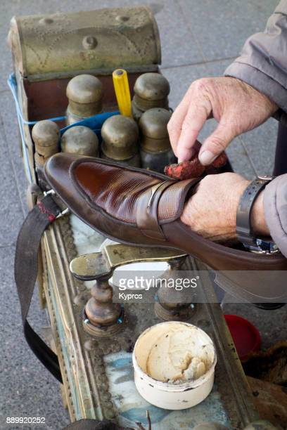 Turkey, Marmaris Area, 2017: Aerial View Of Man Polishing Leather Shoes. The (Tourist) Price Was 5 Turkish Lira (1.3 Euro Or $1.5 USD) Per Pair.