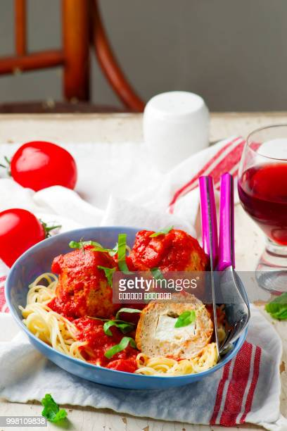Turkey  meat balls stuffed with feta cheese in tomato sauce