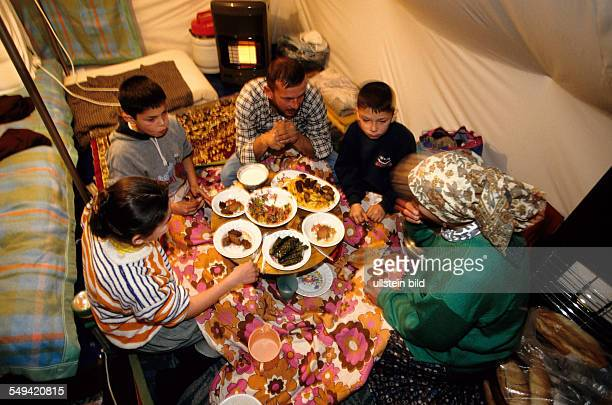 TUR Turkey Mittelmeer Duezce After the earthquake The provisional accommodation/tent city a family having dinner in their homemade home