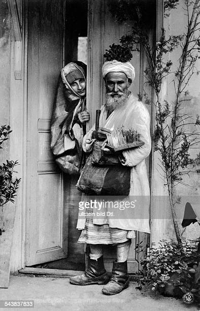 Turkey Ottoman Empire 18601912 Constantinople Istanbul Street vendor is offering his goods a young woman at her doorstep 1907 Published by 'Berliner...