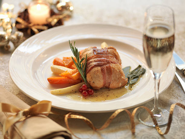 Turkey Parcel Wrapped In Pancetta, Stuffed With Cranberry And Orange And Served With Lemon And Sage Sauce With Roasted Winter Vegetables, Amid Festive Decorations Wall Art