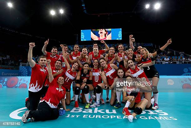Turkey players and staff celebrate winning gold after the Women's Volleyball gold medal match between Turkey and Poland on day fifteen of the Baku...