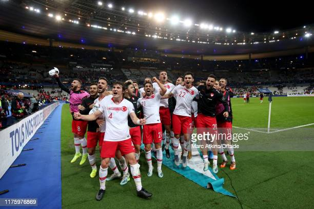 Turkey players celebrate after the UEFA Euro 2020 qualifier between France and Turkey on October 14, 2019 in Saint-Denis, France.