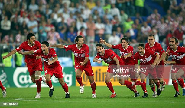 Turkey players celebrate after winning the penalty shoot out during the UEFA EURO 2008 Quarter Final match between Croatia and Turkey at Ernst Happel...