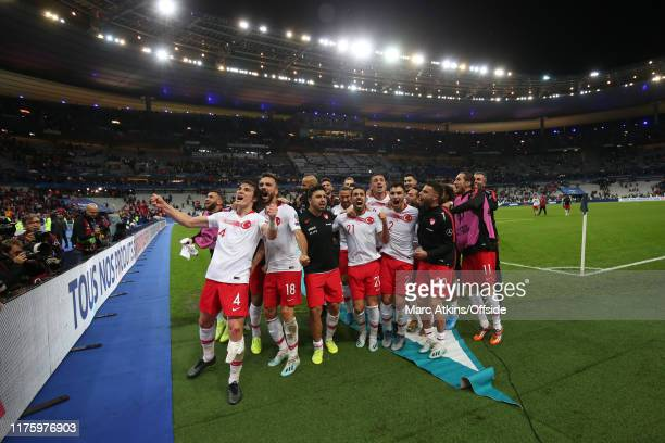 Turkey players celebrate the draw after the UEFA Euro 2020 qualifier between France and Turkey on October 14, 2019 in Saint-Denis, France.
