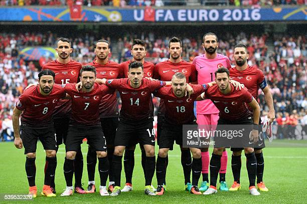Turkey players line up for the team photos prior to the UEFA EURO 2016 Group D match between Turkey and Croatia at Parc des Princes on June 12 2016...