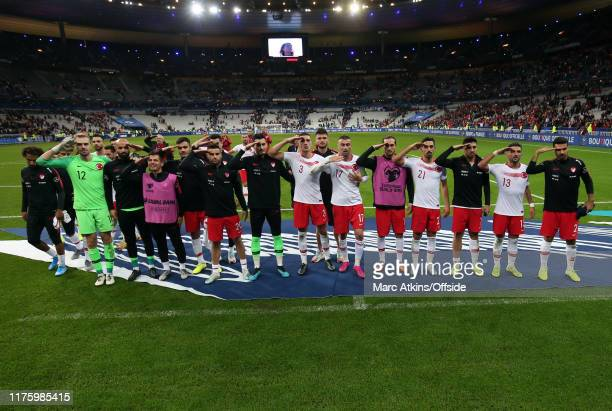 Turkey players salute as the celebrate the 1-1 draw during the UEFA Euro 2020 qualifier between France and Turkey on October 14, 2019 in Saint-Denis,...