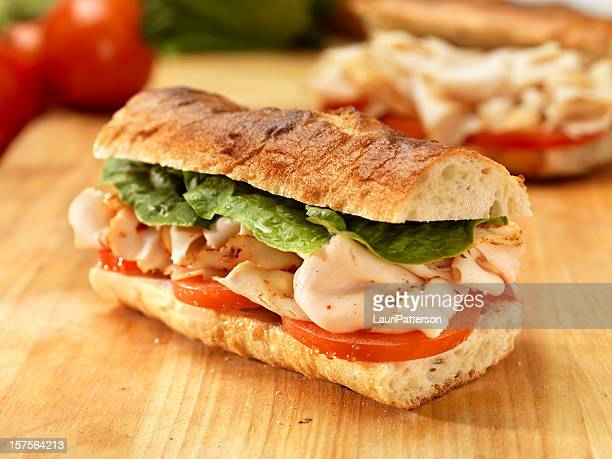 turkey sandwich on a baguette - submarine sandwich stock pictures, royalty-free photos & images
