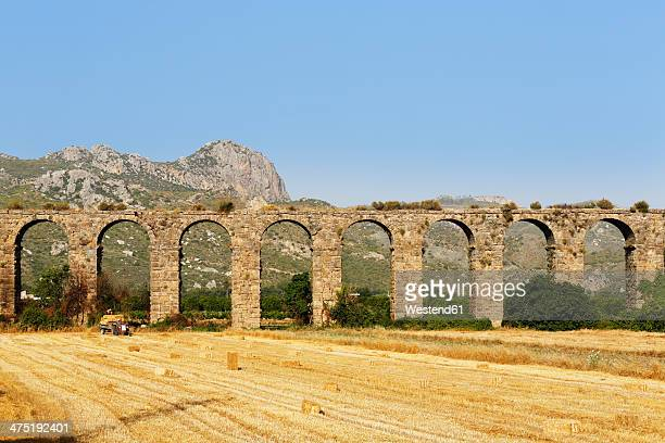 Turkey, Serik, ancient town Aspendos, Aqueduct and stubble field