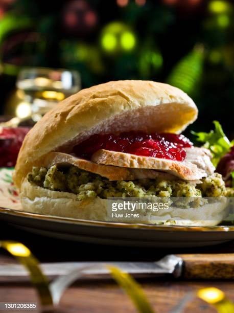 turkey, stuffing & cranberry sauce sandwich - national holiday stock pictures, royalty-free photos & images