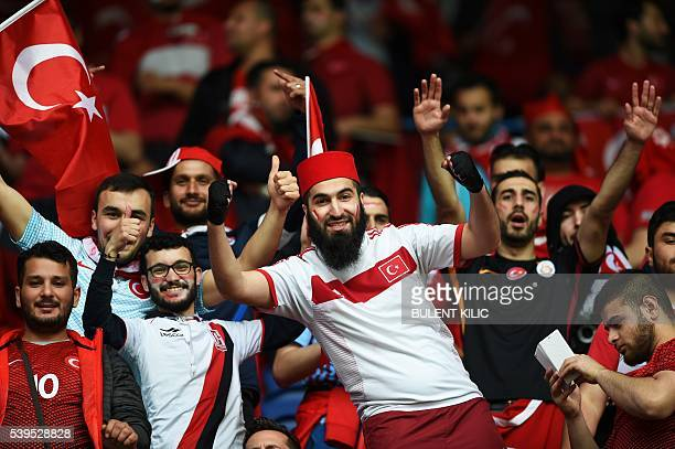 TOPSHOT Turkey supporters gather as they wait for the start of the Euro 2016 group D football match between Turkey and Croatia at Parc des Princes in...