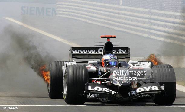 Tires of Minardi Dutch driver Robert Doornbos' car burn on the Istanbul racetrack during the qualifying session on the eve of the Turkish Grand Prix...