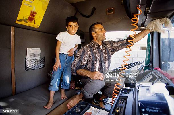 TUR Turkey Turkey on its way to Europe A truck which transports goods into the Iraq A truck driver with his son