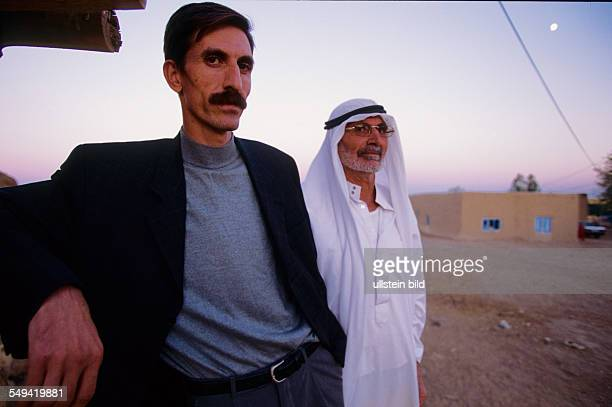 Turkey, Turkey on its way to Europe. Haremres, Karatepe: Village at the turkish syrian border. Hueseyin Cangir, left, director of the IHD with her...