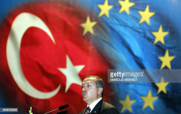 Turkish Prime Minister Recep Tayyip Erdogan delivers a speech in Istanbul on 12 October 2005 during the visit of German Chancellor Gerhard Schroeder...