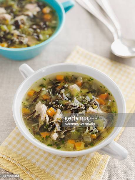 turkey wild rice soup - thanksgiving leftovers stock photos and pictures