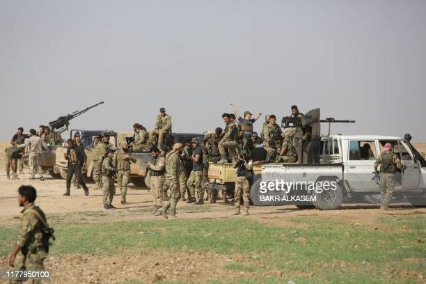 Turkeybacked Syrian fighters take over areas on the road between Tal Abyad and Kobane on October 24 as Kurdish forces in northeastern Syria left...