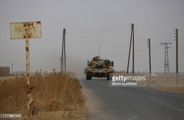 Turkey-backed Syrian fighters take over areas on the road between Tal Abyad and Kobane on October 24 as Kurdish forces in northeastern Syria left...