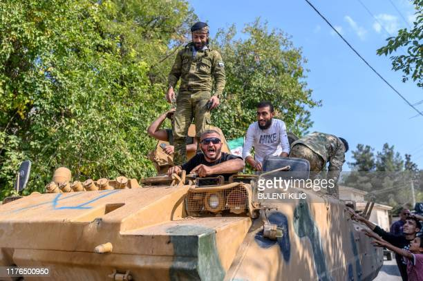 Turkey-backed Syrian National Army fighters drive in Sanliurfa, on October 18, 2019 as they head for Akcakale border town to reach Tal Abyad in...