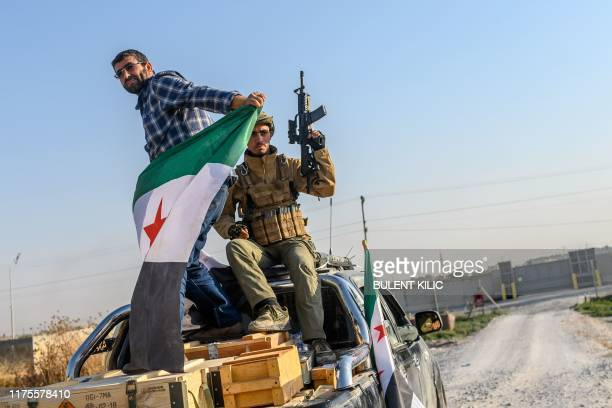 Turkey-backed Syrian National Army fighters leaves on October 13, 2019 the Turkish city of Akcakale for the Syrian border city of Tal Abyad, on the...