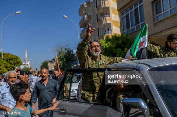 Turkey-backed Syrian opposition fighters going to Tal Abyad from Turkish gate towards Syria in Akcakale in Sanliurfa province on October 10, 2019. -...