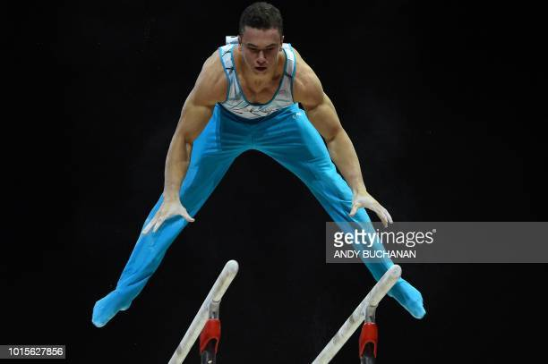 Turkey's Ahmet Onder competes in the men's parallel bars final of the artistic gymnastics at the SSE Hydro during the 2018 European Championships in...