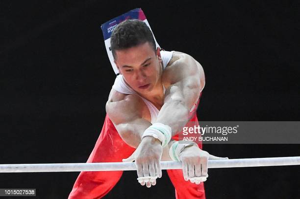 Turkey's Ahmet Onder competes on the rings in the men's team final of the artistic gymnastics at the SSE Hydro during the 2018 European Championships...