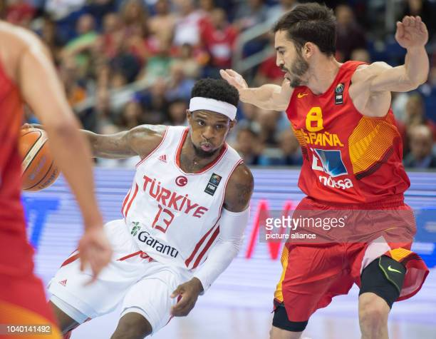 Turkey's Ali Muhammed and Spain's Pau Ribas compete for the ball during the European Championship basketball match between Spain and Turkey at the...