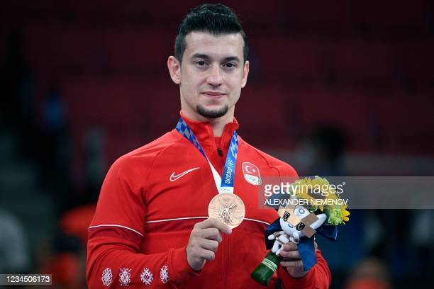Turkey's Ali Sofuoglu poses with his men's kata bronze medal on the podium at a ceremony in the karate competition during the Tokyo 2020 Olympic...