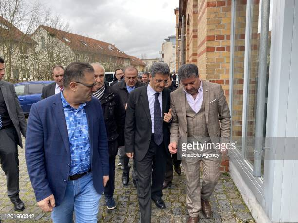 Turkey's Ambassador to Berlin, Ali Kemal Aydin gathers with the citizens on the scene of shootings at a shisha bar and a cafe that left 9 dead...