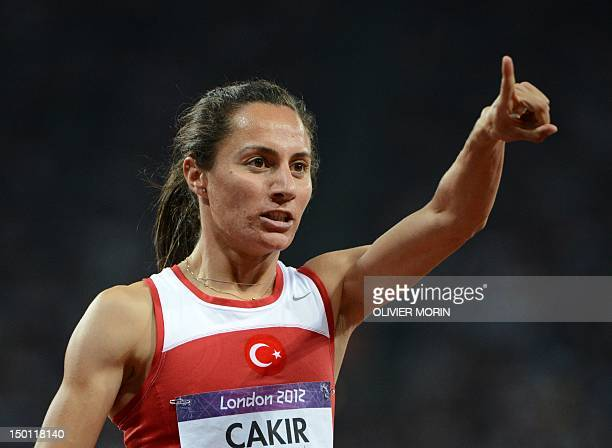 Turkey's Asli Cakir Alptekin celebrates after winning the women's 1500m final at the athletics event of the London 2012 Olympic Games on August 10...