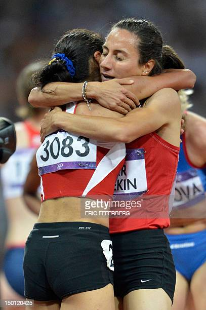 Turkey's Asli Cakir and Turkey's Gamze Bulut celebrates after competing in the women's 1500m final at the athletics event of the London 2012 Olympic...