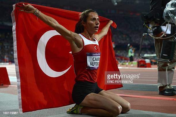Turkey's Asli Cakir celebrates after winning the women's 1500m final at the athletics event of the London 2012 Olympic Games on August 10 2012 in...