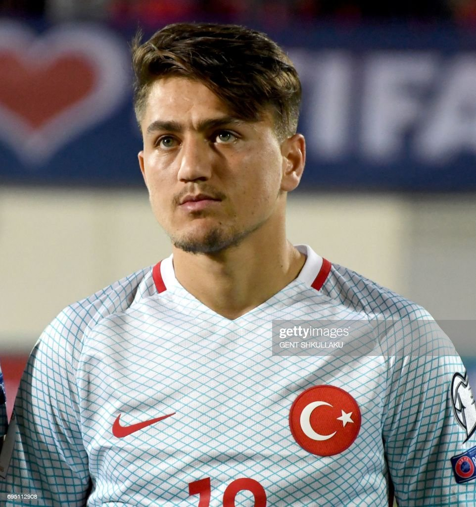 Turkey's Cengiz Under looks on prior the FIFA World Cup 2018 qualification football match between Kosovo and Turkey in Loro Borici stadium in the city of Shkoder on June 11, 2017. / AFP PHOTO / Gent SHKULLAKU