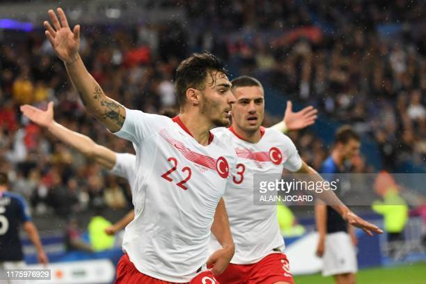Turkey's defender Kaan Ayhan celebrates past Turkey's defender Merih Demiral after scoring the equalizer during the Euro 2020 Group H qualification...