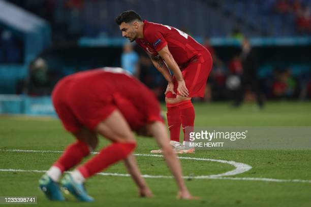 Turkey's defender Kaan Ayhan looks dejected after his team lost the UEFA EURO 2020 Group A football match between Turkey and Italy at the Olympic...