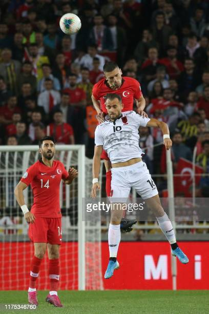 Turkey's defender Merih Demiral heads the ball next to Albania's forward Rey Manaj during the Euro 2020 football qualification match between Turkey...