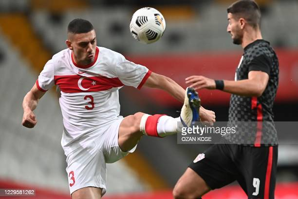 Turkey's defender Merih Demiral is challenged by Croatia's forward Antonio Colak during the friendly football match between Turkey and Croatia at the...
