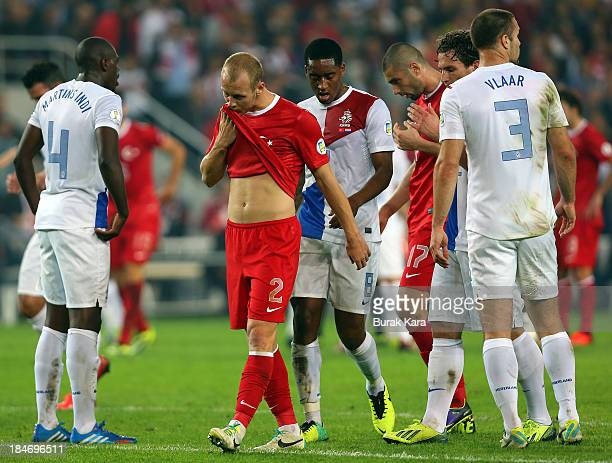 Turkey's defender Semih Kaya stands dejected during FIFA 2014 World Cup Qualifier match at the Sukru Saracoglu Stadium on October 15 2013 in Istanbul...