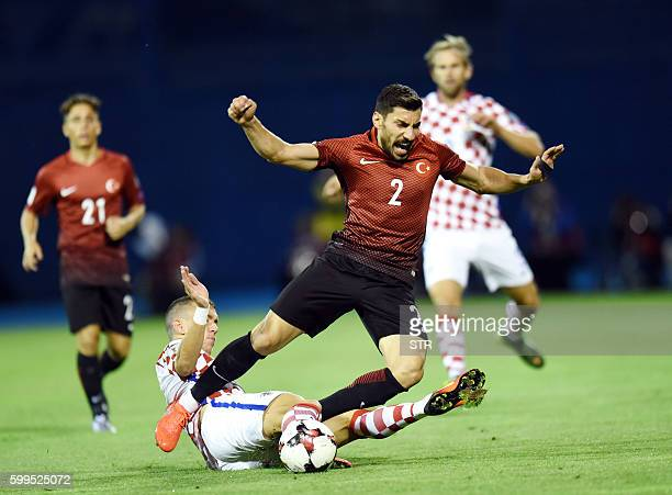 TOPSHOT Turkey's defender Sener Ozbayrakli vies with Croatia's midfielder Ivan Perisic during the World Cup 2018 qualifier football match Croatia vs...