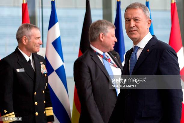 Turkey's Defense Minister Hulusi Akar looks on as he arrives for a meeting of NATO defense ministers at NATO headquarters in Brussels on June 26 2019