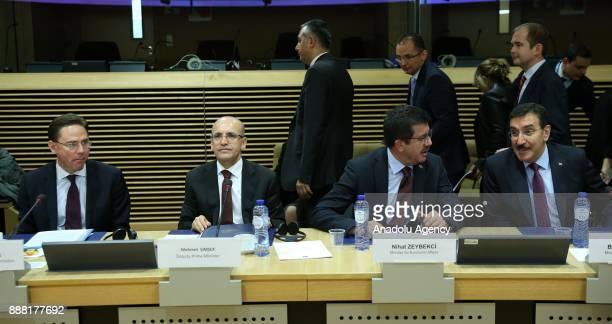 Turkeys Deputy Prime Minister Mehmet Simsek Economy Minister Nihat Zeybekci Customs and Trade Minister Bulent Tufenkci and European Commissioner in...