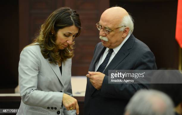 Turkey's Education Minister Nabi Avci talks to German Commissioner for Immigration Refugees and Integration Aydan Ozoguz ahead of the joint press...